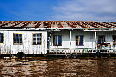 Exterior view of house boat on brown river, Vietnam, Mekong Delta