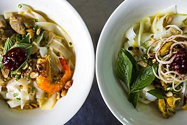 High angle close up of Mi Quang noodles, a Vietnamese specialty, Vietnam