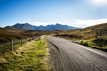 Landscape with rural road hills and mountains in the distance, Scotland