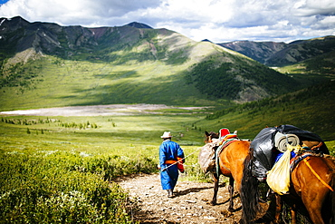 Guides and travelers ride horses into the East Taiga forests of northern Mongolia to visit the remote, nomadic reindeer herders that live near the Siberian borders of the country, Mongolia