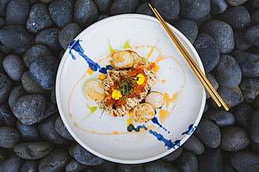 High angle close up of scallop somen with fish roe, ebi, and salted egg yolk sauce, Singapore