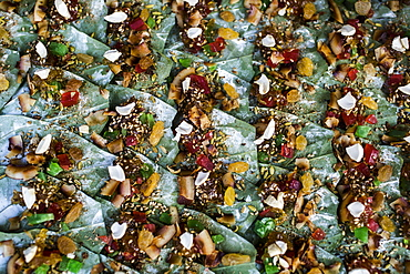 High angle close up of betel nuts wrapped in leaves on a street market, Myanmar