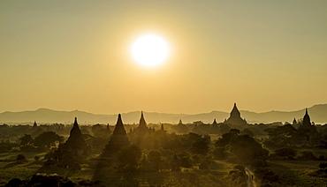 Sunset over stupas of temples in Bagan, Bagan, Myanmar