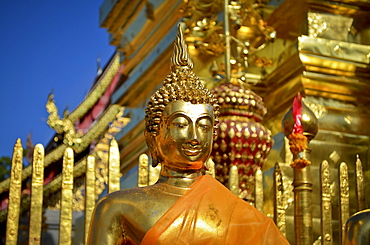 Close up of golden Buddha statue outside temple, Bagan, Myanmar