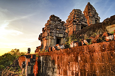 Ankor Wat, a 12th century historic Khmer temple and UNESCO world heritage site. Arches and carved stone blocks and steps at sunset, Angkor Wat, Cambodia