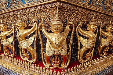 Close up of statues at the golden shrine at Wat Pho Buddhist temple complex in the Phra Nakhon District, Bangkok, Thailand