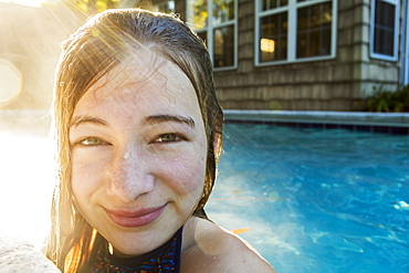 Portrait of a teenage girl in a swimming pool, head and shoulders, St Simon's Island, Georgia, United States
