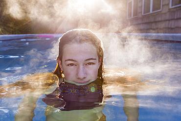 A teenage girl swimming in a pool, St Simon's Island, Georgia, United States