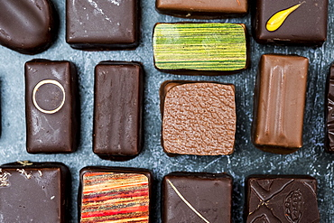 High angle close up of a selection of chocolate pralines, United Kingdom