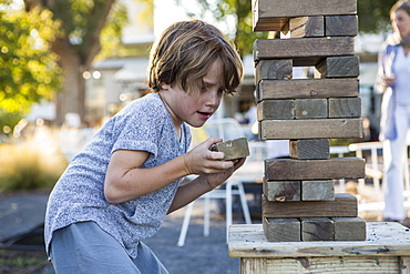 A young boy playing with giant jigsaw puzzle, United States
