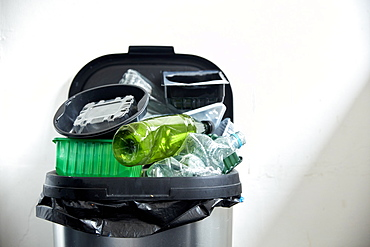 Used plastic containers filling up kitchen dustbin, Bristol, United Kingdom