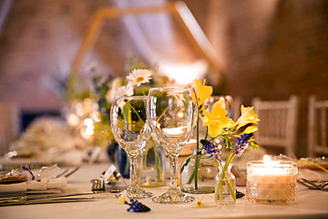 Close up of festive place setting for a naming ceremony in an historic barn