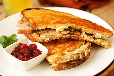 Close up of toasted sourdough mushroom melt with chutney in a cafe