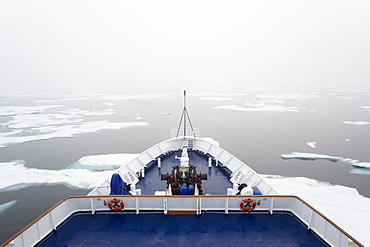 The view over the decks of a cruise ship in the Canadian Arctic region, moving through ice floes, Canada