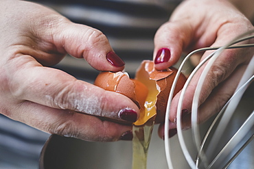 Cook separating eggs for baking