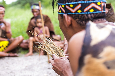 San People, a bushman creating fire from dry kindling, a cultural demonstration