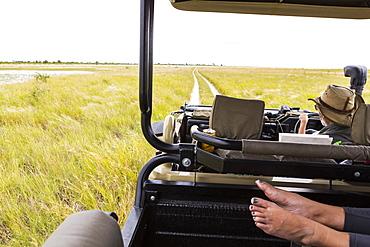 feet in safari vehicle, Botswana
