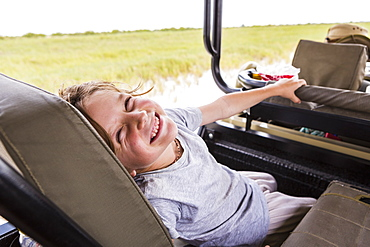 Six year old boy in safari vehicle, Botswana
