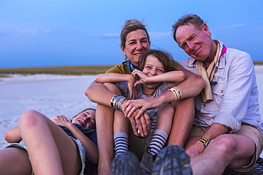 smiling family on top of safari vehicle, Nxai Pan, Botswana
