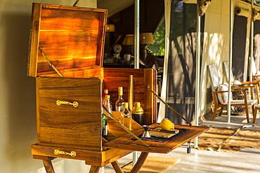 wooden liquor cabinet, at a safari camp, Maun, Botswana