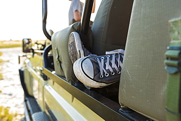 A person's sneaker in a jeep window