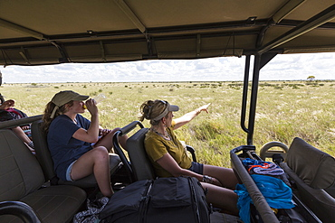 mother and daughter in safari vehicle
