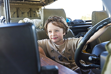 portrait of Six year old boy in safari vehicle