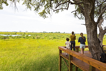 mother and kids at tented camp, Botswana
