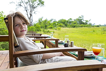 Six year old boy overlooking scenic landscape, Botswana