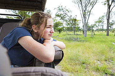 Thirteen year old girl in safari vehicle, Botswana