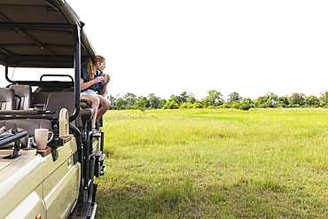 Thirteen year old girl on safari vehicle, Botswana