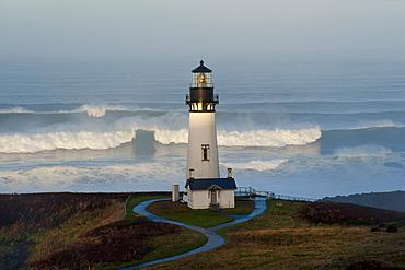 The historic Yaquina Head tower lighthouse on a headland overlooking the Pacific coastline, Yaquina Head, Oregon, USA