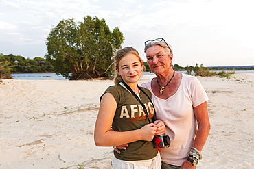 A senior woman and teenage girl, grandmother and her twelve year old grand daughter on vacation