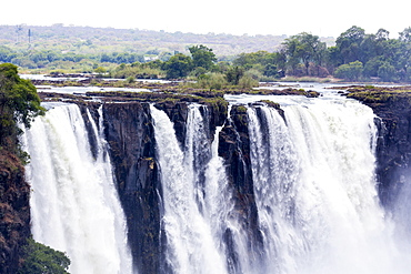 Victoria Falls, waterfall on the Zambezi River, cascades of water tumbling over a steep cliff, Victoria Falls, Zambia
