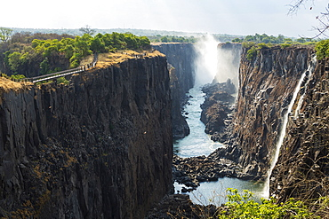Victoria Falls viewed from the Zambian side, deep gorge with vertical sides, waterfall with torrents of white water, Victoria Falls, Zambia