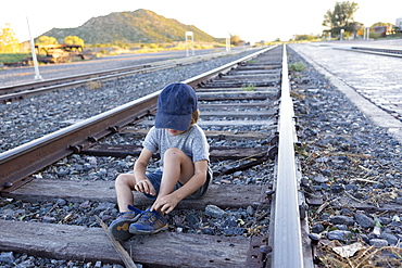 4 year old boy on railroad tracks Lamy, New Mexico