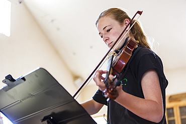 Teenage girl playing violin, New Mexico, United States