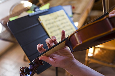 close up of hands playing violin, New Mexico, United States