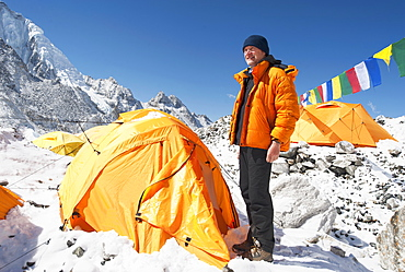 Man standing at base camp tent, Khumbu region, Nepal