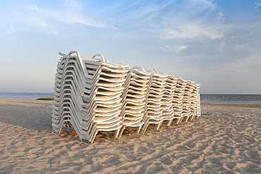 Stacked Lounge Chairs on a Beach, Estonia