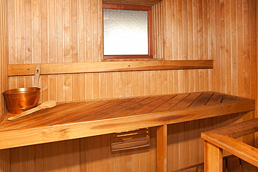 Empty Spa sauna interior, wooden clad walls and seating, Estonia