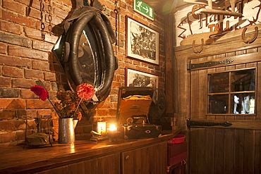 A hotel with old fashioned retro styled rooms, and rustic objects, bar with horse harness, Estonia