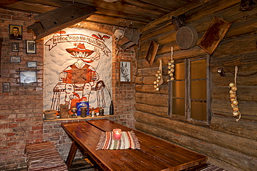A hotel with old fashioned retro styled rooms, and rustic objects, bench and tables, Estonia