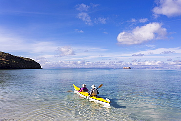 Couple in a kayak, paddling on the Sea of Cortes, also known as the Gulf of California, Mexico