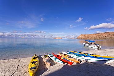 Colorful kayaks lying on the beach, Isla Espiritu, Mexico
