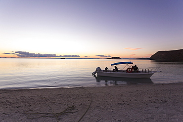Power boat moored near beach at sunset, Sea of Cortes, Mexico