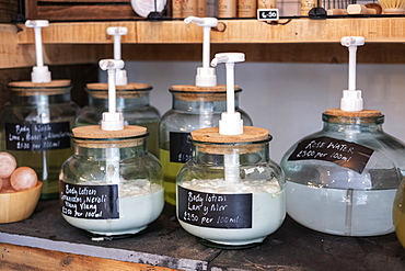 Close up of glass jar dispensers of beauty products in a waste free wholefood store, Watlington, Oxfordshire, United Kingdom