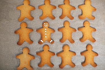 High angle close up of Gingerbread Men on a baking tray