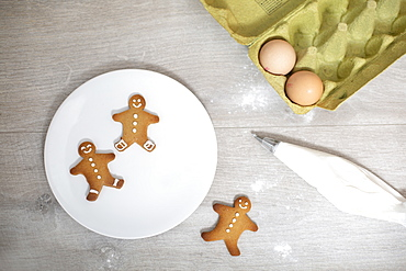High angle close up of Gingerbread Men on a white plate