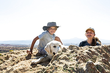 young boy and his teen sister with their dog, New Mexico, United States of America